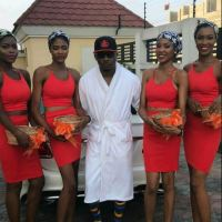 He isssss Baaaacck: Pretty Mike, Shows Up In Bobrisky's House Warming Party In A Bathrobe And Flanked By Flower Girl