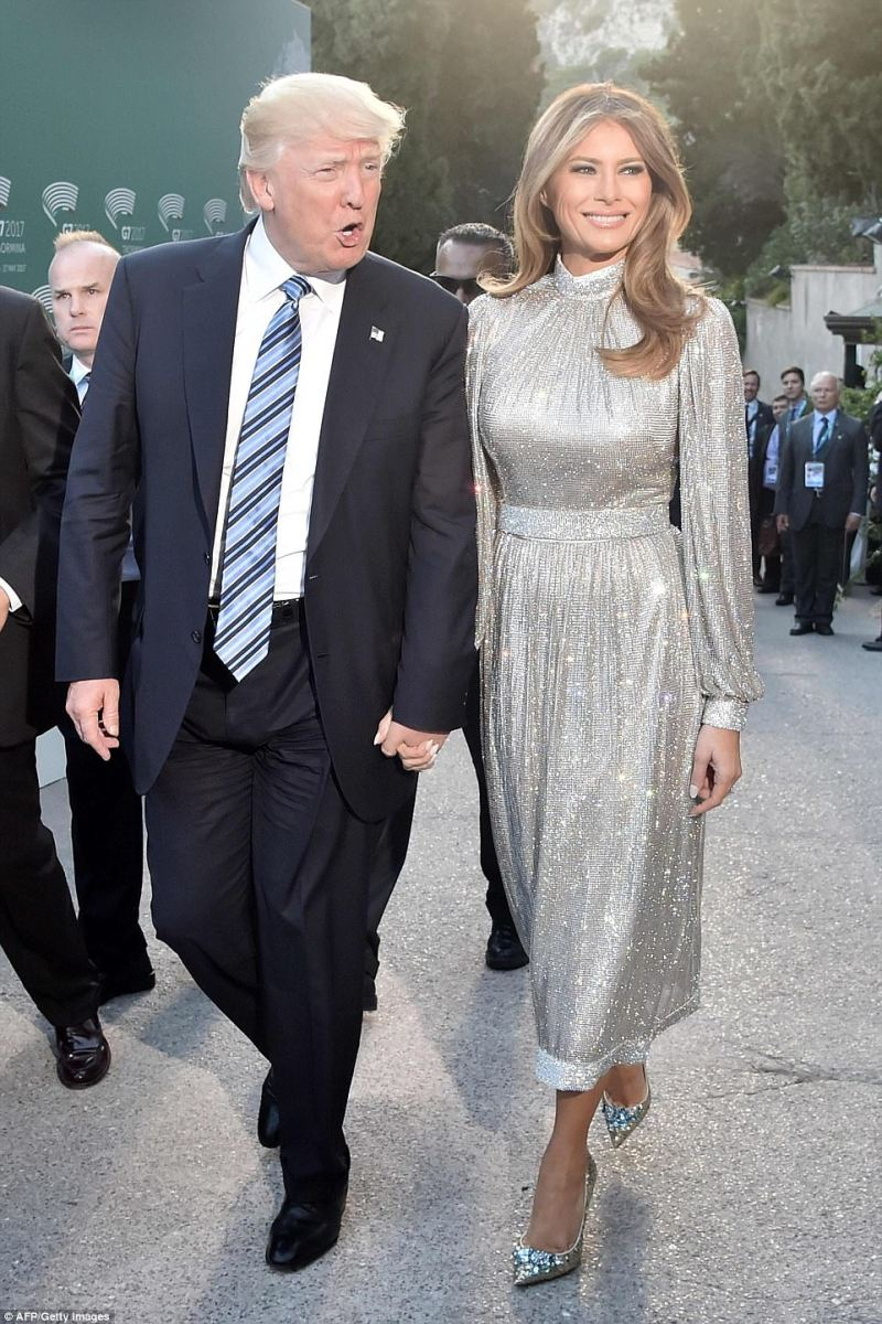 Dazzling! Melania Trump holds Donald's hand as she arrives at concert for G7 leaders and their spouses in a custom Dolce & Gabbana gown, after donning the label's $51,500 jacket earlier in the day
